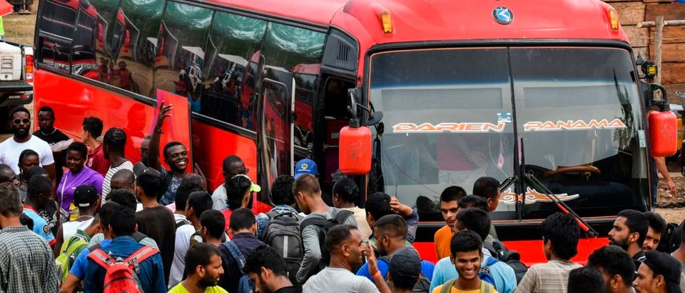 Migrants wait to board a bus heading to the border with Costa Rica at the Temporary Station of Humanitarian Assistance (ETAH) in La Penita village, Darien province, Panama on May 23, 2019. - Migrants mainly from Haiti, Cuba, Democratic Republic of Congo, India, Cameroon, Bangladesh and Angola cross the border between Colombia and Panama through the Darien Gap on their way to the United States. They escape poverty, political prosecution or lack of opportunities in their countries. Some of them die in the journey while others report thefts and violations. They arrive in Panama undernourished, dehydrated, sometimes without money and harassed by human traffickers. (Photo by Luis ACOSTA / AFP) (Photo credit should read LUIS ACOSTA/AFP/Getty Images)