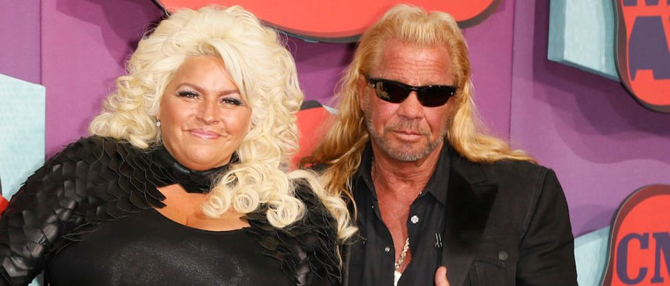 Television show personalities Beth and Dog Chapman arrive at the 2014 CMT Music Awards in Nashville, Tennessee June 4, 2014. REUTERS/Eric Henderson