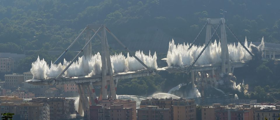The pylons 10 and 11 of the collapsed Morandi viaduct are demolished with a controlled dynamite explosion on June 28, 2019 in Genoa, Italy. The Morandi viaduct collapsed on August 14, 2018 causing the death of 43 people. (Photo by Pier Marco Tacca/Getty Images)