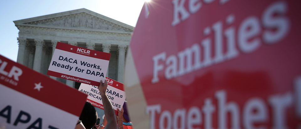 Pro-immigration activists gather in front of the Supreme Court on April 18, 2016. (Alex Wong/Getty Images)