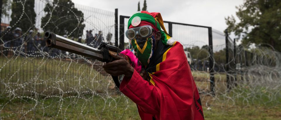 An EFF supporter is seen ahead of a protest march. Brent Stirton/Getty Images