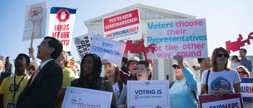 Demonstrators protest outside the Supreme Court as the justices hear arguments against gerrymandering on October 3, 2017. (Jim Watson/AFP/Getty Images)