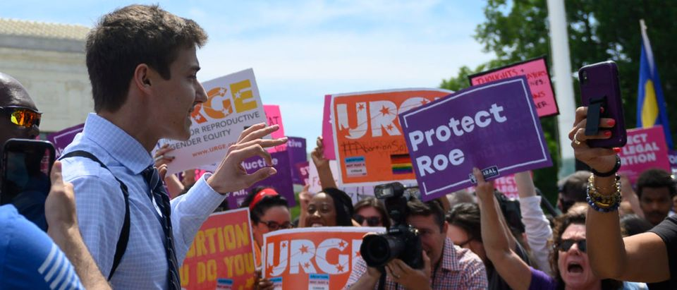 Pro-life activist Boris Kizenko (L) gestures at pro-choice activists during a rally in front of the U.S. Supreme Court in Washington, D.C., on May 21, 2019. (ANDREW CABALLERO-REYNOLDS/AFP/Getty Images)
