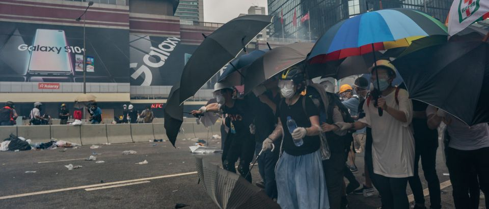 HONG KONG -- JUNE 12: Protesters hold umbrellas as teargas is fired during a demonstration on June 12, 2019 in Hong Kong. (Photo by Anthony Kwan/Getty Images)