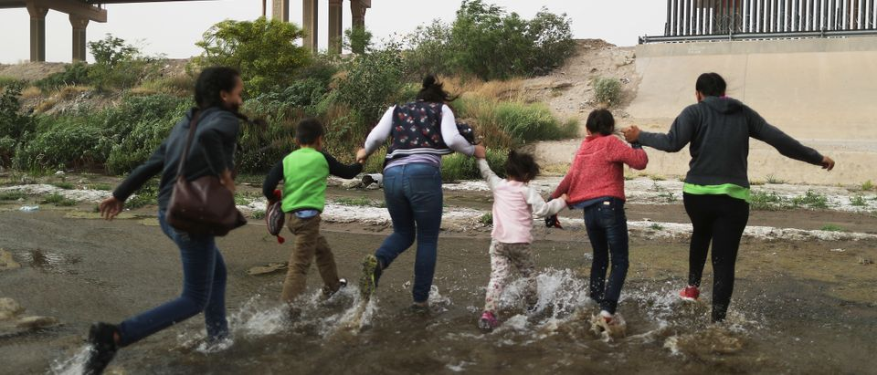 Migrants cross the border between the U.S. and Mexico at the Rio Grande river, as they enter El Paso, Texas, on May 20, 2019 as taken from Ciudad Juarez, Mexico. (Mario Tama/Getty Images)