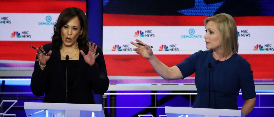 MIAMI, FLORIDA - JUNE 27: Democratic presidential candidate Sen. Kamala Harris (L) (D-CA) and Sen. Kirsten Gillibrand (D-NY) speak during the second night of the first Democratic presidential debate on June 27, 2019 in Miami, Florida. A field of 20 Democratic presidential candidates was split into two groups of 10 for the first debate of the 2020 election, taking place over two nights at Knight Concert Hall of the Adrienne Arsht Center for the Performing Arts of Miami-Dade County, hosted by NBC News, MSNBC, and Telemundo. (Photo by Drew Angerer/Getty Images)