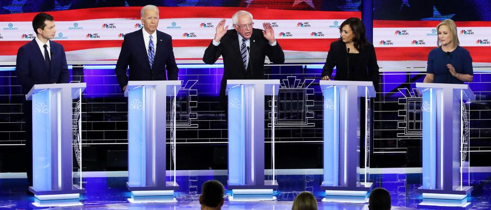 Democratic presidential candidate Sen. Bernie Sanders (I-VT) (3nd-R) speaks while South Bend, Indiana Mayor Pete Buttigieg (L-R) , former Vice President Joe Biden, and Sen. Kamala Harris (D-CA) and Sen. Kirsten Gillibrand (D-NY) listen in the second night of the first Democratic presidential debate on June 27, 2019 in Miami, Florida. (Drew Angerer/Getty Images)