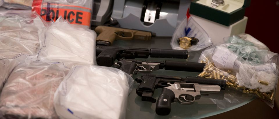 Part of the 18kg of cocaine, 20 kg of cannabis, 300.000 euros and weapons seized by French police. (KENZO TRIBOUILLARD/AFP/Getty Images)