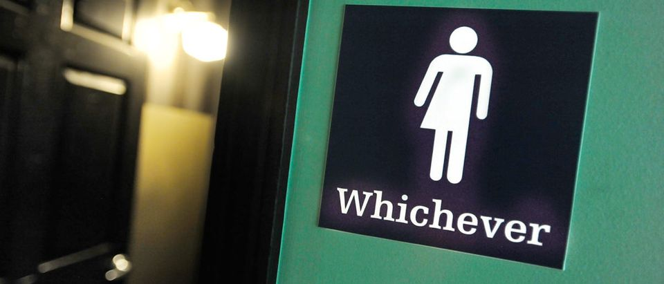 A gender neutral sign is posted outside a bathrooms at Oval Park Grill on May 11, 2016 in Durham, North Carolina. (Sara D. Davis/Getty Images)