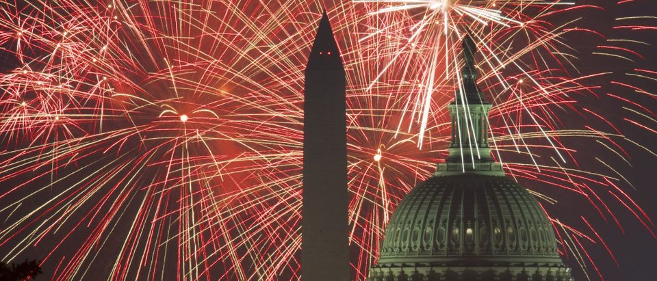 Fireworks explode over the National Mall as the US Capitol (R) and National Monument are seen on July 4, 2017, in Washington, DC. (PAUL J. RICHARDS/AFP/Getty Images)