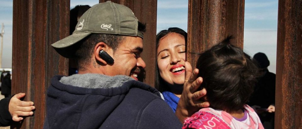 "Members of a family reunite through the border wall between Mexico and United States, during the ""Keep our dream alive"" event, in Ciudad Juarez, Chihuahua state, Mexico on December 10, 2017.uman Rights Day. (HERIKA MARTINEZ/AFP/Getty Images)"