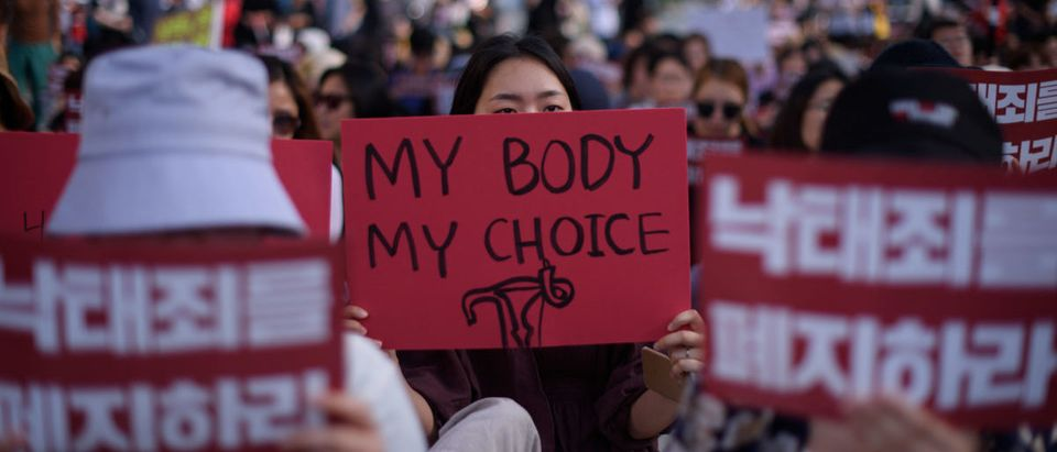 Protesters hold placards reading 'Abolish punishment for abortion' as they protest South Korean abortion laws in Gwanghwamun plaza in Seoul on July 7, 2018. (Ed JONES / AFP)