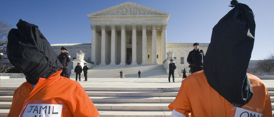 Protesters stand in front of the U.S. Supreme Court during the International Day to Shut Down Guantanamo protest on Jan. 11, 2007, in Washington, D.C. (Paul Richards/AFP/Getty Images)
