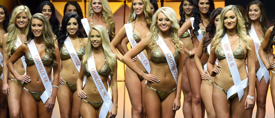 LAS VEGAS, NV - JULY 13: (L-R) Kristen Cooper of Chantilly, Virginia, Amanda Withee of Charlotte, North Carolina, Shai Poag of Chattanooga, Tennessee and Robyn Mackowski of Chicago, Illinois compete in the 20th annual Hooters International Swimsuit Pageant at The Pearl concert theater at Palms Casino Resort on July 13, 2016 in Las Vegas, Nevada. (Photo by Ethan Miller/Getty Images)