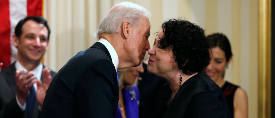 Former Vice President Joe Biden kisses Supreme Court Justice Sonia Sotomayor after taking the oath of office on January 20, 2013. (Kevin Lamarque/Pool/Getty Images)