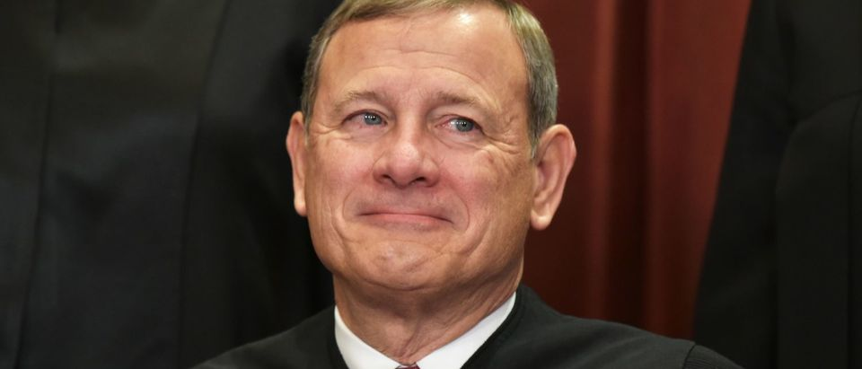 Chief Justice John Roberts poses for an official group photo at the US Supreme Court on November 30, 2018. (Mandel Ngan/AFP/Getty Images)