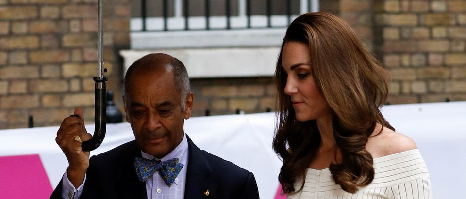 Britain's Catherine, Duchess of Cambridge is welcomed by Kenneth Olisa, the Lord-Lieutenant of Greater London holding an umbrella as she arrives at the Addiction Awareness Week Gala Dinner in London, Britain, June 12, 2019. REUTERS/Peter Nicholls
