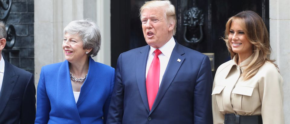 Britain's Prime Minister Theresa May, U.S. President Donald Trump and first lady Melania Trump stand in front of Downing Street 10, as part of Trump's state visit in London, Britain, June 4, 2019. REUTERS/Simon Dawson
