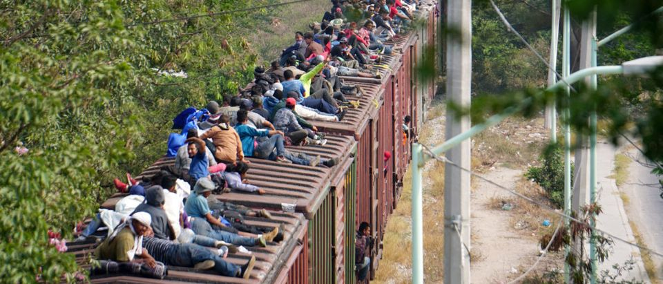 FILE PHOTO: Central American migrants ride train through Juchitan, Oaxaca