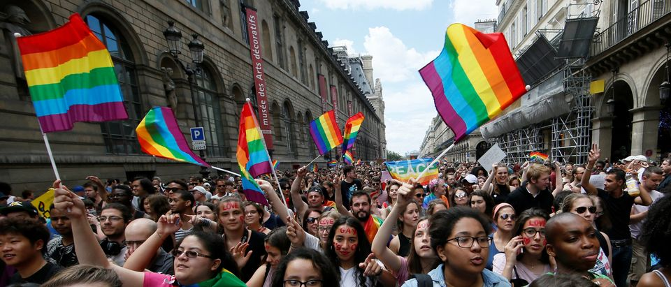 Participants take part in the annual Gay Pride parade in Paris, France June 24, 2017. REUTERS/Gonzalo Fuentes
