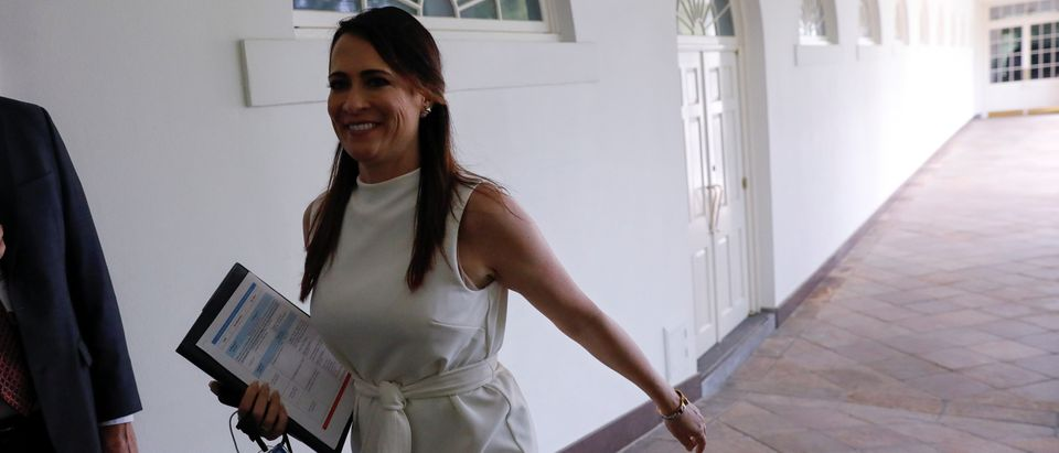 Stephanie Grisham, communications director for first lady Melania Trump and a longtime aide to President Donald Trump, walks along the Colonnade after it was announced she will succeed Sarah Sanders as White House press secretary at the White House in Washington, U.S., June 25, 2019. REUTERS/Carlos Barria