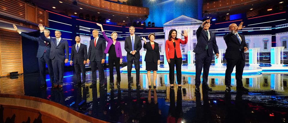 Democratic 2020 presidential candidates New York City Mayor Bill de Blasio, U.S. Rep. Tim Ryan, former HUD Secretary Julian Castro, U.S. Senator Cory Booker, U.S. Senator Elizabeth Warren, former U.S. Rep. Beto O'Rourke, Senator Amy Klobuchar, U.S. Rep. Tulsi Gabbard, Washington Governor Jay Inslee and former U.S. Rep. John Delaney pose together before the start of the first U.S. 2020 presidential election Democratic candidates debate in Miami, Florida, U.S., June 26, 2019. REUTERS/Carlo Allegri