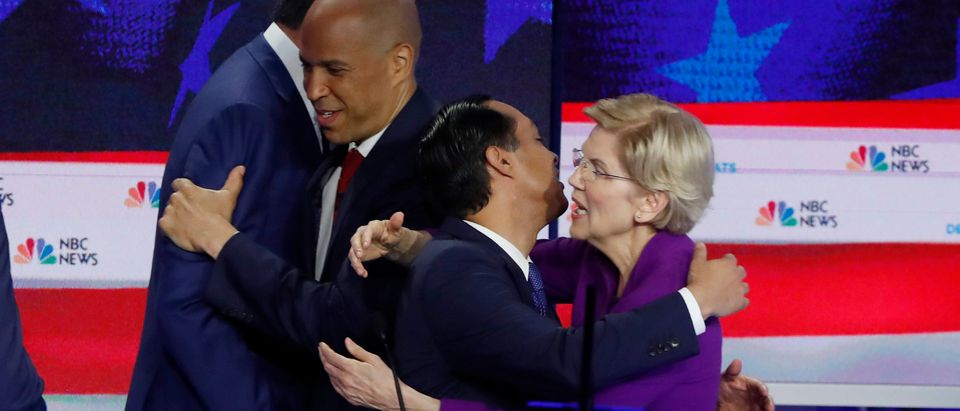 Candidates embrace at the conclusion of the first U.S. 2020 presidential election Democratic candidates debate in Miami, Florida, U.S.