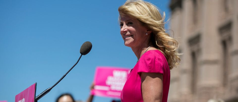 Former Texas State Senator Wendy Davis addresses the crowd during a Planned Parenthood rally outside the State Capitol in Austin