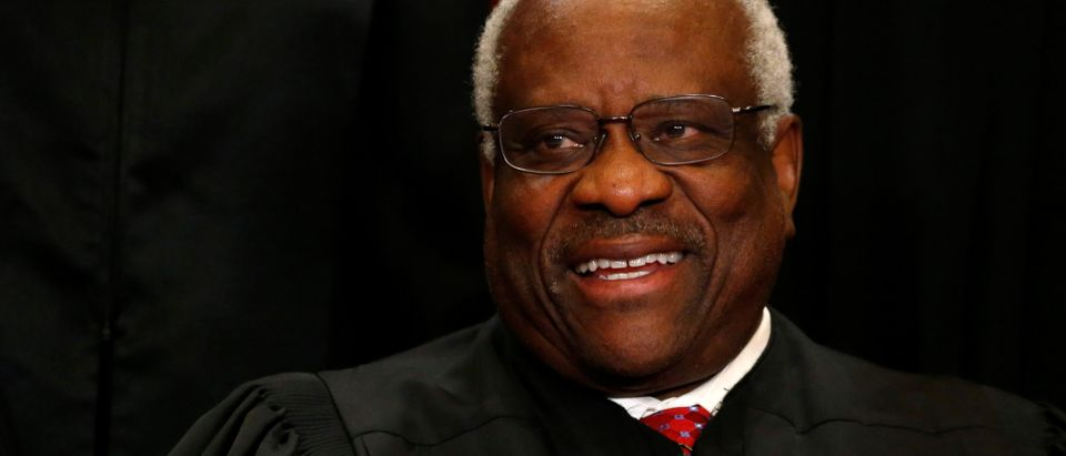 U.S. Supreme Court Justice Clarence Thomas participates in taking a new family photo with his fellow justices at the Supreme Court building in Washington, D.C., U.S., June 1, 2017. REUTERS/Jonathan Ernst