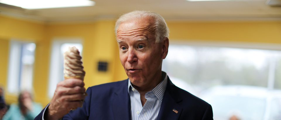 2020 Democratic presidential candidate U.S. former Vice President Biden quips that it's awkward to talk about foreign policy to reporters with an ice cream cone in his hand, at the Cone Shoppe during a two-day campaign kickoff in Monticello