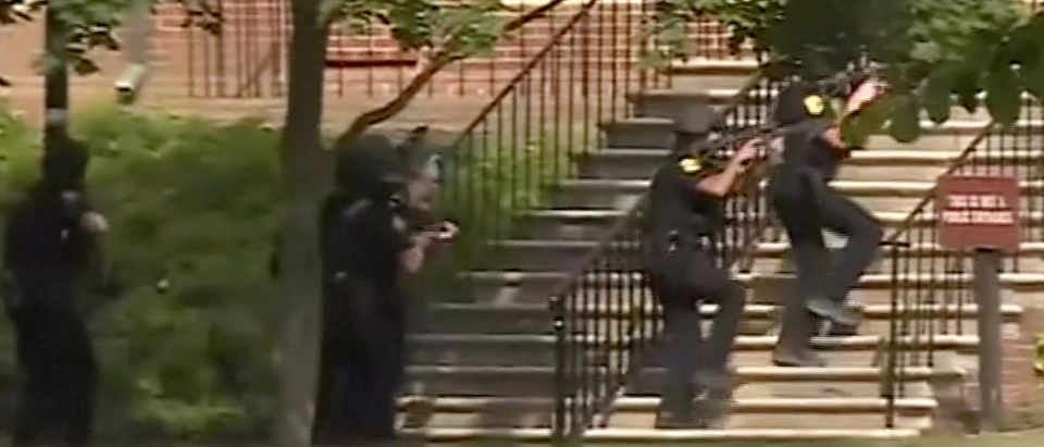 Police enter a building in this still image taken from video following a shooting incident at the municipal center in Virginia Beach, Virginia, U.S. May 31, 2019. WAVY-TV/NBC/via REUTERS