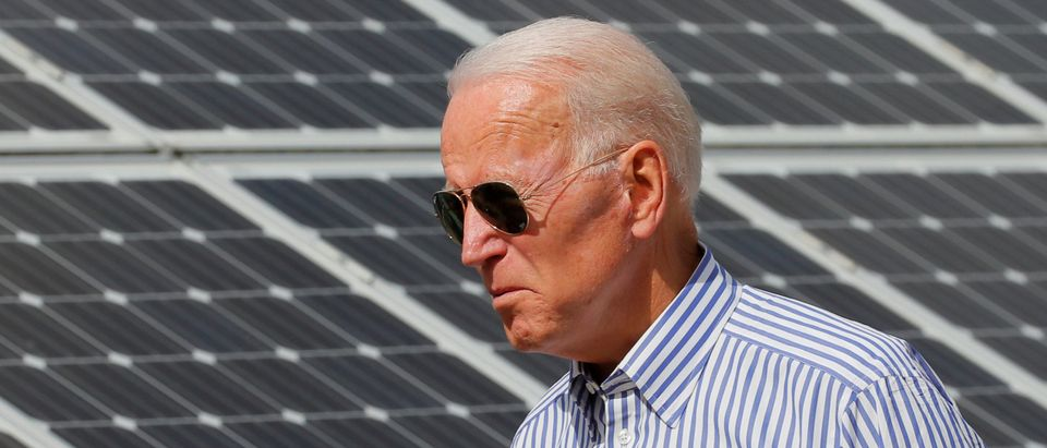 Democratic 2020 U.S. presidential candidate Biden walks past solar panels in Plymouth