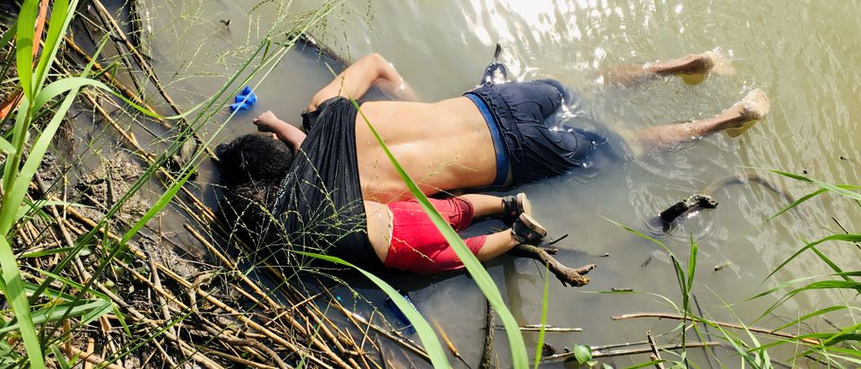 REFILE - CORRECTING STYLE. ATTENTION EDITORS - SENSITIVE MATERIAL. THIS IMAGE MAY OFFEND OR DISTURB The bodies of Salvadoran migrant Oscar Alberto Martinez Ramirez and his daughter Valeria are seen at the Rio Bravo river in Matamoros, in Tamaulipas state, Mexico June 24, 2019. Picture taken June 24, 2019. REUTERS/Stringer