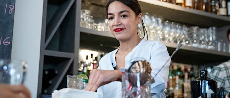 Rep. Alexandria Ocasio-Cortez (D-NY) works behind the bar at the Queensboro Restaurant, May 31, 2019 in the Queens borough of New York City