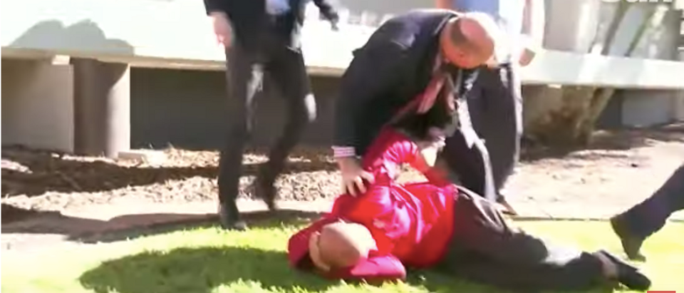 Australian detective Daren Edwards tackles a man suspected of inappropriate conduct in the middle of a recorded interview.