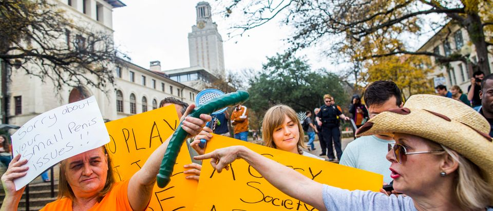 Gun activists clash with protesters close to The University of Texas campus December 12, 2015 in Austin, Texas. In addition to the event put on by DontComply.com, a gun activist organization, the group also held an open carry walk earlier in the day. (Photo by Drew Anthony Smith/Getty Images)