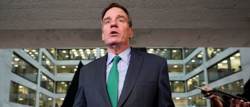 U.S. Senator and Senate Intelligence Committee ranking member Mark Warner speaks to reporters inside the Hart Senate Office Building where former Trump personal attorney Michael Cohen testified behind closed doors before the committee on Capitol Hill in Washington, U.S., February 26, 2019. REUTERS/Kevin Lamarque