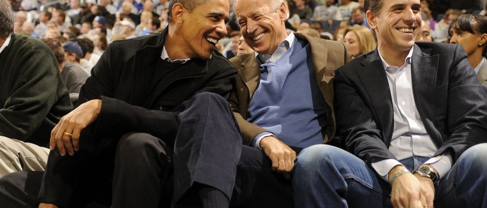 President of the United States Barack Obama and Vice President Joe Biden and Hunter Biden (son of Joe Biden) talk during a college basketball game between Georgetown Hoyas and the Duke Blue Devils on January 30, 2010 at the Verizon Center in Washington DC. (Photo by Mitchell Layton/Getty Images)