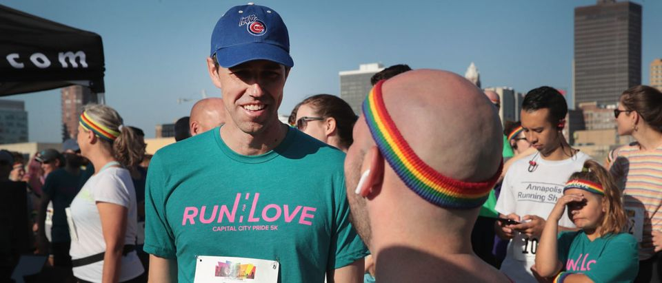 Democratic presidential candidate and former Texas Congressman Beto O'Rourke speaks with other runners as he prepares to participate in the Pride Fest Fun Run 5K on June 8, 2019 in Des Moines, Iowa. (Photo by Scott Olson/Getty Images)
