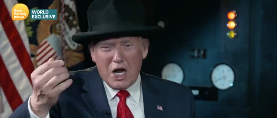 """Trump tries on Churchill hat on """"Good Morning Britain"""" with Piers Morgan. Screen Shot/ITV"""