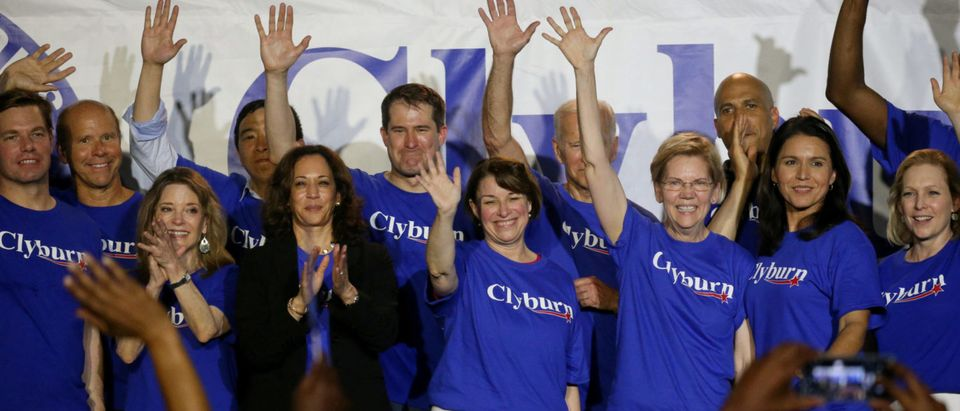 Democratic presidential candidates stand on stage together, including all of the women running, Marianne Williamson, Sen. Kamala Harris, Sen. Amy Klobuchar, Sen. Elizabeth Warren, Rep. Tulsi Gabbard, and Sen. Kirsten Gillibrand during Jim Clyburn's World Famous Fish Fry in Columbia, South Carolina, U.S., June 21, 2019. REUTERS/Leah Millis