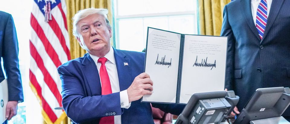 President Donald Trump signs at the White House on June 24, 2019, 'hard-hitting sanctions' on Iran's supreme leader. (MANDEL NGAN/AFP/Getty Images)