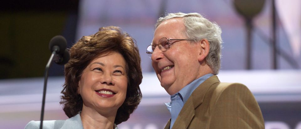 Republican Senator Mitch McConnell and his wife, Elaine Chao, check the podium the day before the start of the Republican National Convention at the Quicken Loans Arena in Cleveland, Ohio on July 17, 2016. (Photo by Jeff Swensen/Getty Images)