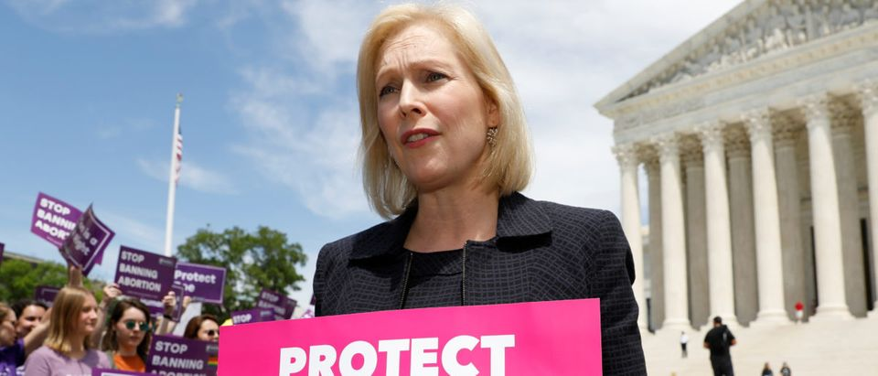 Democratic 2020 presidential candidate and Senator Kirsten Gillibrand holds a protest sign in front of a crowd of abortion rights demonstrators during a rally outside the U.S. Supreme Court (REUTERS/Kevin Lamarque)