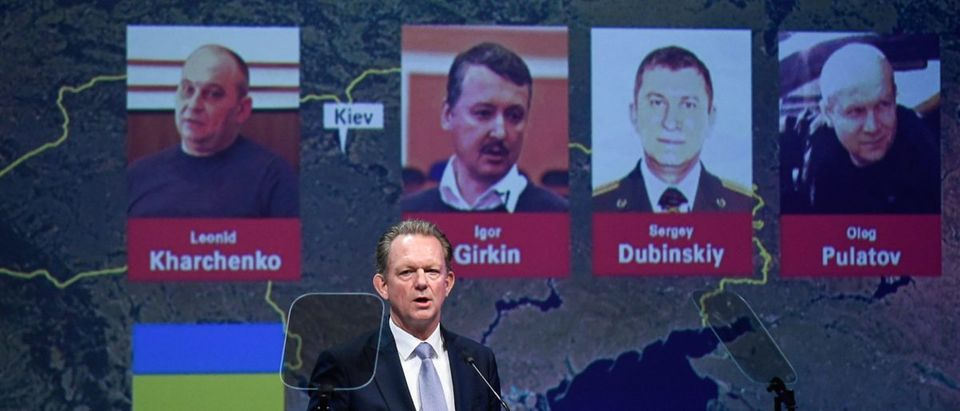 Chief Prosecutor with the National Prosecutor's Office of the Netherlands Fred Westerbeke delivers a speech during a press conference of the Joint Investigation Team on June 19, 2019 in Nieuwegein, on the ongoing investigation of the Malaysia Airlines MH17 crash in 2014, next to the pictures of (from LtoR) Ukrainian Leonid Kharchenko, former FSB colonel Igor Girkin (Strelkov), Sergei Dubinsky employed by Russia's GRU military intelligence agency and former soldier of the Spetznaz GRU Oleg Pulatov. - The Dutch-led probe said it was going to prosecute Russian nationals Girkin, Sergei Dubinsky and Oleg Pulatov as well as Ukrainian Leonid Kharchenko, adding they would be placed on national and international wanted lists, over the downing of the Malaysia Airlines plane in July, 2014 when it was shot out of the sky by a BUK missile. (Photo: JOHN THYS/AFP/Getty Images)