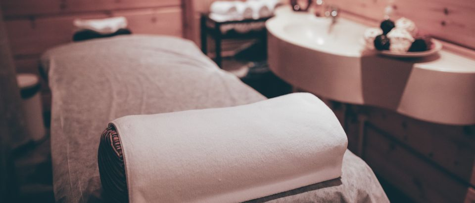 A massage parlor was one of four businesses raided in connection with human trafficking. (kondr.konst/Shutterstock)