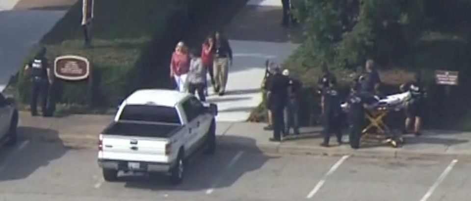 Police evacuate people from a building as a stretcher stands by in this still image taken from video following a shooting incident at the municipal center in Virginia Beach, Virginia, U.S. May 31, 2019. WAVY-TV/NBC/via REUTERS