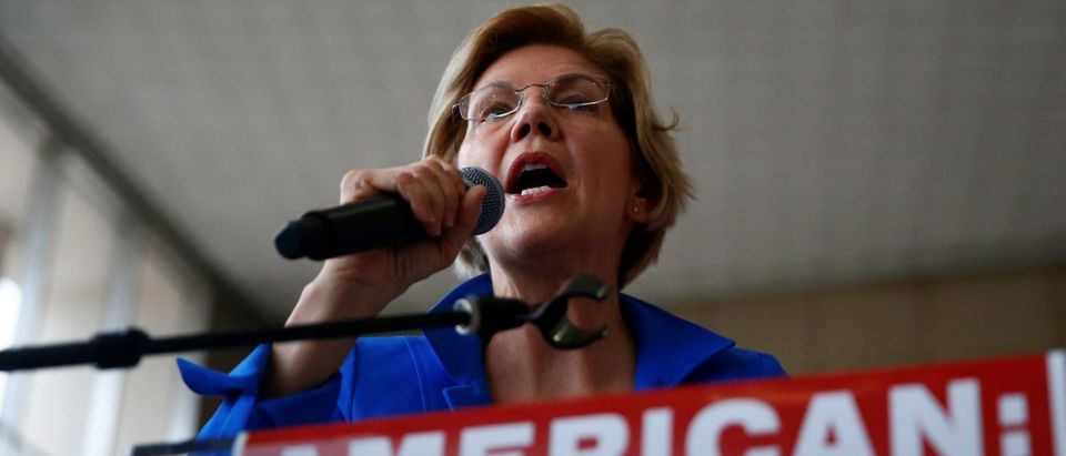 2020 presidential candidate Sen. Elizabeth Warren (MA) addresses airline food workers and representatives from UNITE HERE during a rally for calling for better wages and health insurance coverage at Reagan National Airport in Arlington