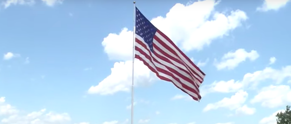 Marcus Lemonis, chairman and CEO of Camping World, says that he won't take his American flag down. Photo YouTube screenshot.