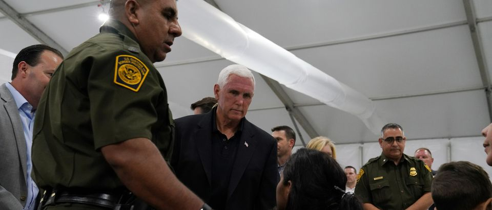 U.S. Vice President Mike Pence talks to asylum-seekers at the Donna Soft-Sided Processing Facility in Donna